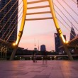 Stock Video: BANGKOK LANDMARK BRIDGE AT SUNSET - CHONGNONSI