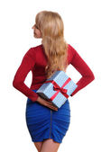 Business woman holding present — Stock Photo