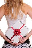Woman holding present — Стоковое фото