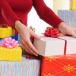 Seller offering a gift — Stock Photo #14170713