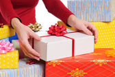 Seller offering a gift — Stock Photo