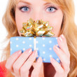 Woman holds a gift box — Stock Photo