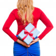 Woman holding present — Stock Photo #19494355