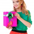 Woman holds a gift box — Stockfoto