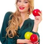 Woman holding apple — Stock Photo