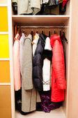 Wardrobe and shirts hanging — Stock Photo