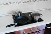 Pots and a frying pan — Stock Photo