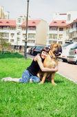 Woman and dog bullmastiff — Stock Photo