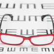Reading eyeglasses and eye chart — Stockfoto
