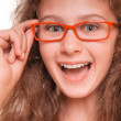 Stock Photo: Girl with reading glasses