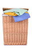 Clothes basket with towels — Stock Photo