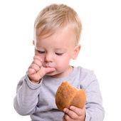 Baby eats bread — Stock Photo
