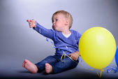 Baby with balloons — Stock Photo