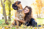 Teen girl and dog — Stock Photo