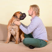 Man with big dog — Stock Photo