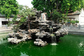 Pond in tepmle — Stock Photo