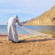 Royalty-Free Stock Photo: Fisherman is pulling out a fishing net