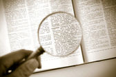 A magnifying glass on the word computer — Stock Photo