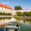 Boat at the pier in the gardens of Wallenstein Palace — Stock Photo