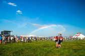 Rainbow in music festival — Stock Photo