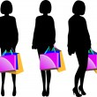 Black silhouette of young woman with shopping bags — Stock Vector