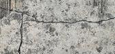 Gebarsten concrete textuur close-up achtergrond. — Stockfoto