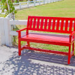 Red wooden chair on the park — Stock Photo