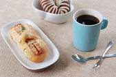 Taro bread, sausage bread and blue cup of coffee — Stockfoto