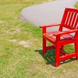 Stock Photo: Red wooden chair on the park