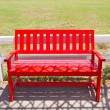 Red wooden chair on the park. — Stock Photo