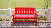 Red wooden chair on the park. — Stok fotoğraf