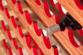 Red wine on Wine Rack — Stock Photo