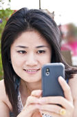 Beautiful Asian woman using a mobile phone. — 图库照片