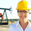 Smiling Female Engineer in an Oilfield — Stock Photo