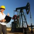 Royalty-Free Stock Photo: Smiling Female Engineer in an Oilfield