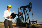 Smiling Female Engineer in an Oilfield — Foto de Stock