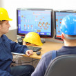 Industrial workers in control room — Stock Photo #39696751