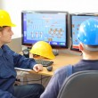Stockfoto: Industrial workers in control room