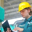 Stockfoto: Industrial worker with notebook