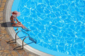 Woman on a swimming pool — Stock Photo