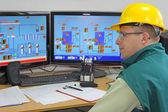 Industrial worker in control room — Stock Photo