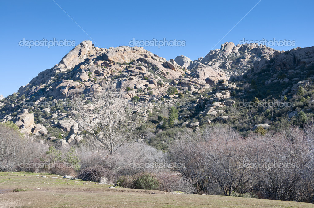 It is a granite mountain where geological forces have create a remarkable boulder field of strangely eroded granite outcrops.  — Stock Photo #21067417