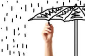 Female hand drawing an umbrella on screen with black marker — Stock Photo