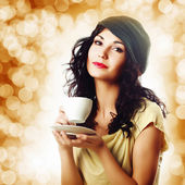 Attractive brunet woman with a cup of coffee — Stock Photo