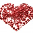 Abstract heart of red beads on white background — Stockfoto