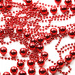 Stock Photo: Red beads as holiday background