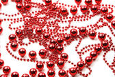 Red beads as holiday background — Stock Photo