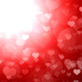 Red shining background with hearts. — Stock Photo