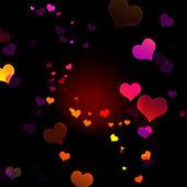 Een heleboel veelkleurige harten op zwarte achtergrond — Stockfoto