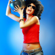 Happy tanned woman with afro haircut enjoying music holding tape recorder. — Stock Photo